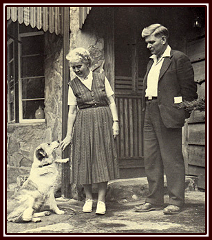 George & Marguerite Bidstrup with their dog by the Bidstrup House